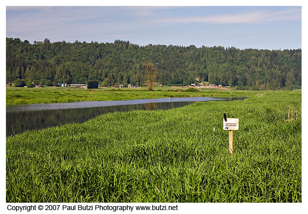 "The sign reads ""Authorized Access Only - Washington FarmBureau"""